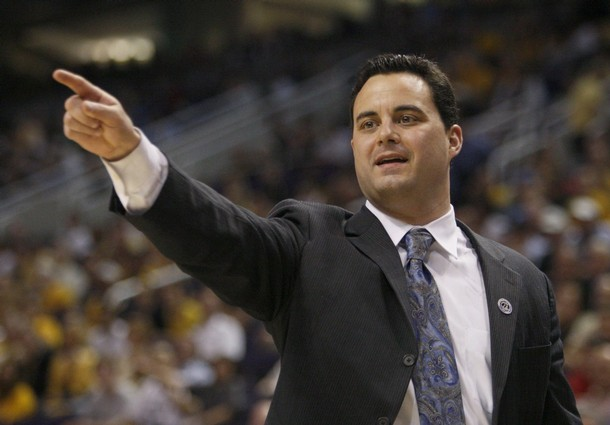Xavier Musketeers head coach Miller directs his team during their NCAA men's basketball game against the West Virginia Mountaineers in Phoenix