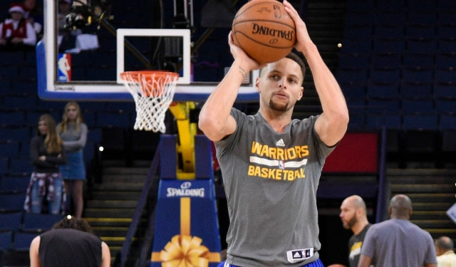 December 25, 2015; Oakland, CA, USA; Golden State Warriors guard Stephen Curry (30) warms up before a NBA basketball game on Christmas against the Cleveland Cavaliers at Oracle Arena. Mandatory Credit: Kyle Terada-USA TODAY Sports