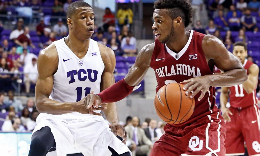 Mar 5, 2016; Fort Worth, TX, USA; Oklahoma Sooners guard Buddy Hield (24) dribbles as TCU Horned Frogs guard Brandon Parrish (11) defends during the second half at Ed and Rae Schollmaier Arena. Mandatory Credit: Kevin Jairaj-USA TODAY Sports ORG XMIT: USATSI-245514 ORIG FILE ID: 20160305_krj_aj6_024.JPG
